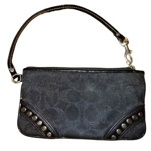Coach black wristlet with silver studs.